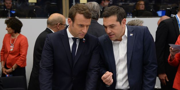 Greek Prime Minister Alexis Tsipras (R) speaks with French President Emmanuel Macron (L) during the NATO (North Atlantic Treaty Organization) summit at the NATO headquarters, in Brussels, on May 25, 2017. / AFP PHOTO / POOL / THIERRY CHARLIER        (Photo credit should read THIERRY CHARLIER/AFP/Getty Images)