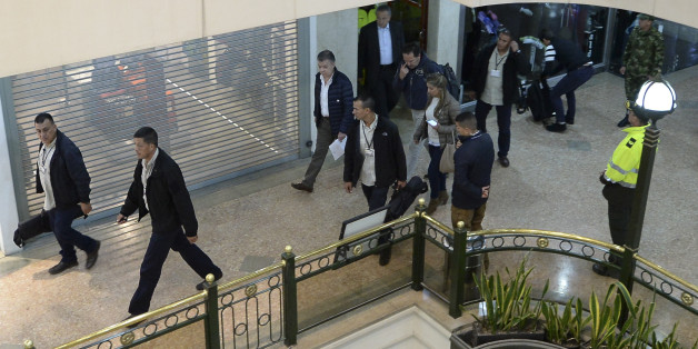 Colombian President Juan Manuel Santos (C) tours a shopping center, following an explosion which, according to authorities, left three dead and eleven injured, in Bogota, Colombia, on June 17, 2017. Police said an explosion tore through a women's restroom area of the mall, crowded with shoppers ahead of Father's Day, in an upscale area of the Colombian capital that is popular with foreign nationals. / AFP PHOTO / Raul Arboleda        (Photo credit should read RAUL ARBOLEDA/AFP/Getty Images)