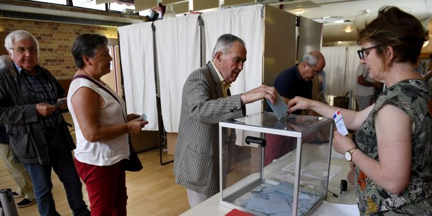 A man casts his vote at a polling station in Carhaix-Plouguer, western France, during the second round of the French parliamentary elections (elections legislatives in French) on June 18, 2017. / AFP PHOTO / Fred TANNEAU        (Photo credit should read FRED TANNEAU/AFP/Getty Images)