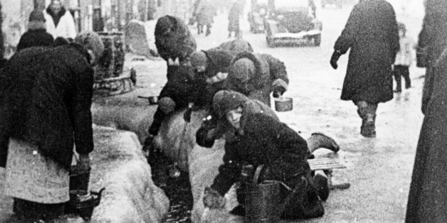 world war ll: the siege of leningrad, women taking water flowing from broken water mains. (Photo by: Sovfoto/UIG via Getty Images)