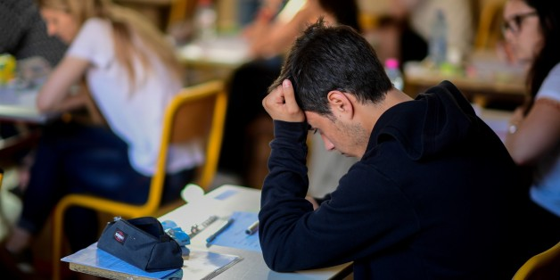 Pupils take part in the first written test in philosophy as part of the Baccalaureat (France's high school diploma) at a school in Paris on June 15, 2017. / AFP PHOTO / Martin BUREAU        (Photo credit should read MARTIN BUREAU/AFP/Getty Images)