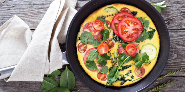 Fresh fritatta with zucchini, spinach and tomatoes