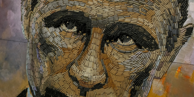 """THIS IMAGE IS BINNED  A portrait of Russian President Vladimir Putin, made out of 5,000 cartridges brought from the frontline in eastern Ukraine, named """"The Face of War"""" is seen in the studio of Ukrainian artist Dariya Marchenko, in Kiev, July 23, 2015. Portrait will be presented along with a novel which will tell personal stories of six people involved in this project including Daria's own story and stories of people who helped her to collect shells from the frontline. Daria Marchenko calls her art approach philosophic symbolism where every element has its hidden meaning. In her works cartridges mean human's life that was brutally ended. Picture taken July 23, 2015.  REUTERS/Gleb Garanich TPX IMAGES OF THE DAY"""