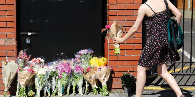 A woman lays flowers in tribute outside Finsbury Park Mosque in the Finsbury Park area of north London, on June 19, 2017, near to where a vehicle was driven into pedestrians. Ten people were injured when a van drove into a crowd of Muslim worshippers near a mosque in London in the early hours of Monday, and a man who had been taken ill before the attack died at the scene. / AFP PHOTO / Tolga AKMEN        (Photo credit should read TOLGA AKMEN/AFP/Getty Images)