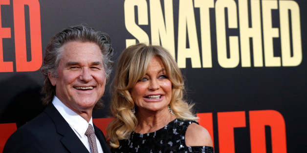 """Cast member Goldie Hawn and actor Kurt Russell pose at the premiere of the movie """"Snatched"""" in Los Angeles, California, U.S., May 10, 2017.   REUTERS/Mario Anzuoni"""