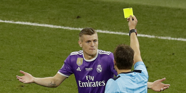 Britain Soccer Football - Juventus v Real Madrid - UEFA Champions League Final - The National Stadium of Wales, Cardiff - June 3, 2017 Real Madrid's Toni Kroos is shown a yellow card by referee Felix Brych  Reuters / Phil Noble Livepic