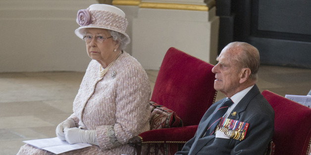 Britain's Queen Elizabeth and Prince Phillip attend a service to commemorate the 70th anniversary of VJ Day in St Martin's in the Fields church, in London, Britain August 15, 2015. REUTERS/Arthur Edwards/Pool