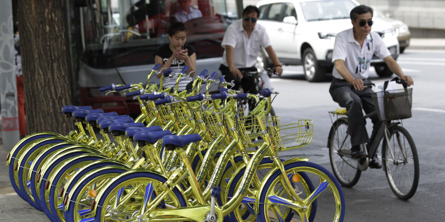 BEIJING, CHINA - JUNE 08:  Golden sharing bikes of a bike-sharing service are available on the street at Chaoyang District on June 8, 2017 in Beijing, China. Golden sharing bikes equipped with wireless charge modules could charge mobile phones in Beijing.  (Photo by VCG/VCG via Getty Images)