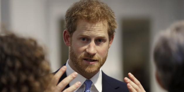 LONDON, UNITED KINGDOM - JUNE 15: Britain's Prince Harry speaks to people during his visit to Chatham House, the Royal Institute of International Affairs on June 15, 2017 in London, England..  Prince Harry visited Thursday to open their new extension, The Stavros Niarchos Foundation Floor, which will provide a permanent home for the Queen Elizabeth II Academy for Leadership in International Affairs, along with new meeting and work spaces. (Photo by Matt Dunham - WPA Pool/Getty Images)