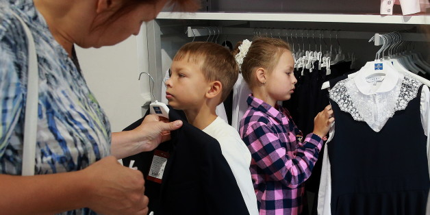 MOSCOW, RUSSIA - AUGUST 13, 2016: Customers in the school uniform section of a Smena store. Smena Holding produces school uniforms and children's clothes. Sergei Fadeichev/TASS (Photo by Sergei Fadeichev\TASS via Getty Images)
