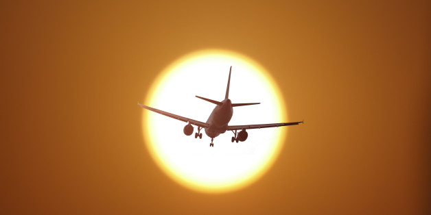 Airplane flying in the sunset