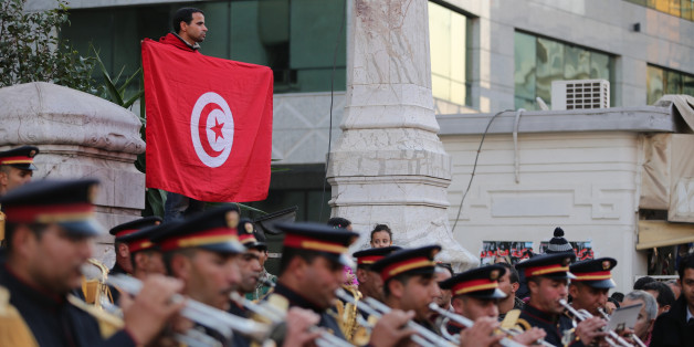 TUNIS, TUNISIA - JANUARY 13:  Tunisian military band performs at the Habib Bourguiba street in Tunis on January 13,2015 during the celebration of the 4th anniversary of the January 14 revolution. (Photo by Nacer Talel/Anadolu Agency/Getty Images)