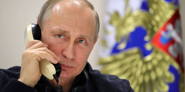 Russian President Vladimir Putin speaks by phone with his Turkish counterpart from aboard the Pioneering Spirit pipelaying ship in the Black Sea on June 23, 2017.Russian President Vladimir Putin on Friday launched the deep-water phase of the TurkStream gas pipeline project, calling Turkey's Recep Tayyip Erdogan from a ship off the Black Sea coast. TurkStream will deliver Russian gas to Turkey and is eventually intended to serve the European Union. / AFP PHOTO / SPUTNIK / Mikhail KLIMENTYEV