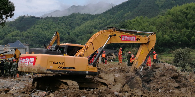 SUICHANG, CHINA - SEPTEMBER 30: Rescue workers search for missing people after the massive landslide on September 30, 2016 in Suichang, China.  Fifteen people were rescued, four bodies were found, and another 23 are still missing.  PHOTOGRAPH BY Feature China / Barcroft Images   London-T:+44 207 033 1031 E:hello@barcroftmedia.com -  New York-T:+1 212 796 2458 E:hello@barcroftusa.com -  New Delhi-T:+91 11 4053 2429 E:hello@barcroftindia.com www.barcroftimages.com (Photo credit should read Feature China / Barcroft Images / Barcroft Media via Getty Images)