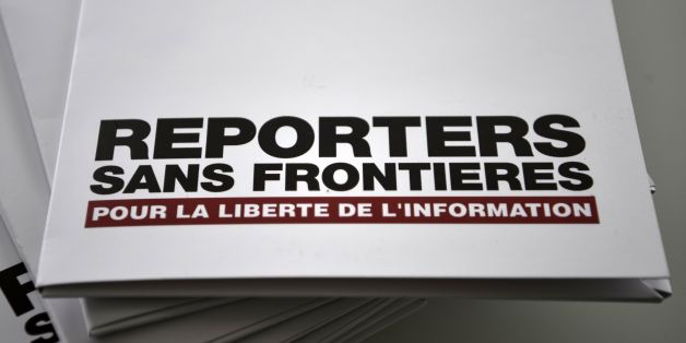 A picture taken on April 26, 2017 at the Agence France Presse (AFP) headquarters in Paris shows copies of the annual World Press Freedom Index of Reporters sans frontieres (RSF - Reporters without borders).