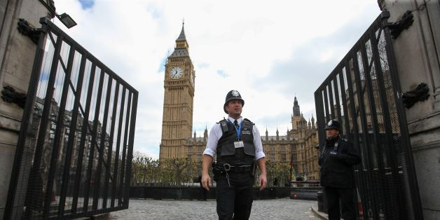 British police officers stand on duty alongside a set of temporary gates installed at the Carriage Gates entrance to the Houses of Parliament, within the Palace of Westminster, in central London on April 12, 2017. / AFP PHOTO / Daniel LEAL-OLIVAS        (Photo credit should read DANIEL LEAL-OLIVAS/AFP/Getty Images)
