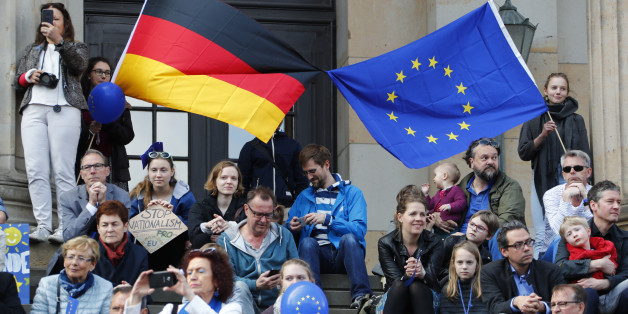 "Participants of the Pro-Europe ""Pulse of Europe"" movement hold European Union and German flags during a protest at Gendarmenmarkt square in Berlin, Germany, April 2, 2017.     REUTERS/Fabrizio Bensch"
