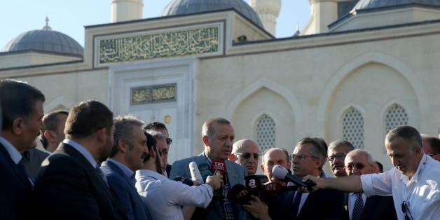 ISTANBUL, TURKEY - JUNE 25 : Turkish President Recep Tayyip Erdogan (C) speaks to media after performing Eid al-Fitr prayer at Mimar Sinan Mosque at Atasehir in Istanbul, Turkey on June 25, 2017. (Photo by Islam Yakut/Anadolu Agency/Getty Images)