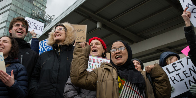 NEW YORK - JANUARY 28: Protesters gather in a demonstration against President Trumps executive order barring immigrants and refugees from certain predominantly Muslim countries outside JFK airport terminal 4 on January 28, 2017 in New York City.PHOTOGRAPH BY Joel Sheakoski / Barcroft Images London-T:+44 207 033 1031 E:hello@barcroftmedia.com - New York-T:+1 212 796 2458 E:hello@barcroftusa.com - New Delhi-T:+91 11 4053 2429 E:hello@barcroftindia.com www.barcroftimages.com (Photo credit should re