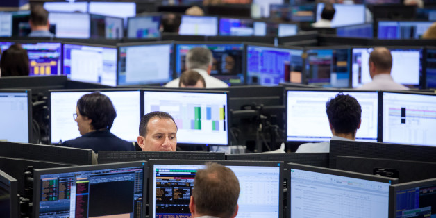 Traders work on the Mizuho Americas trading floor in New York, U.S., on Wednesday, April 26, 2017. Mizuho Financial Group Inc. is seeking to boost its presence in Yankee bonds -- dollar-denominated bonds issued in the U.S. by foreign entities -- in a bid to tap into its global network and boost fee income from some of Asia and Europe's largest companies. Photographer: Michael Nagle/Bloomberg via Getty Images