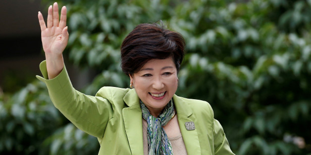 Tokyo Governor and head of Tokyo Citizens First party Yuriko Koike waves to voters atop of a campaign van as election campaign officially kicks off for Tokyo Metropolitan Assembly election, on the street in Tokyo June 23, 2017.    REUTERS/Issei Kato