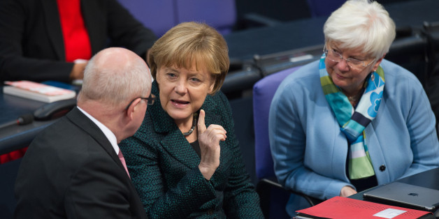 German Chancellor Angela Merkel (C) talks to Volker Kauder (R), parliamentary faction leader of the Christian Democratic Union (CDU), next to Gerda Hasselfeld, Christian Social Union (CSU) Bundestag faction leader, at the lower house of parliament Bundestag in Berlin, November 26, 2014. REUTERS/Stefanie Loos (GERMANY  - Tags: POLITICS)