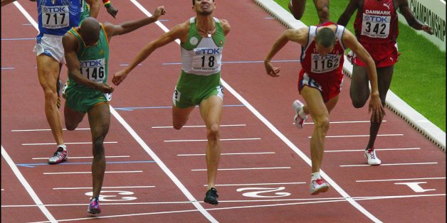 FRANCE - AUGUST 31:  9Th Athletics World Championship In St Denis. On August 31, 2003 In Saint-Denis, France. Algeria'S Djabir Said-Guerni, Centre, Crosses The Line Ahead Of Russia'S Yuriy Borzakovskiy, Right, And South Africa'S Mbulaeni Mulaudza, Left, To Win The Gold Medal In The Men'S 800 Meters At The World Athletics Championships In The Stade De France, Saint Denis.  (Photo by Gilles BASSIGNAC/Gamma-Rapho via Getty Images)