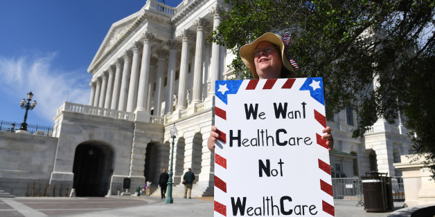 WASHINGTON, June 27, 2017 -- A woman protests against the new health care bill on Capitol in Washington D.C., the United States, June 27, 2017. The U.S. Senate draft bill to repeal and replace the Obamacare would increase the number of people without health insurance by 22 million by 2026, the nonpartisan Congressional Budget Office said Monday. (Xinhua/Yin Bogu via Getty Images)