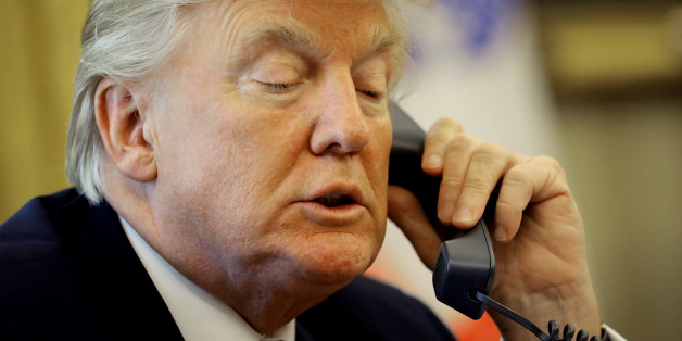 U.S. President Donald Trump waits on the line as he call Prime Minister Leo Varadkar of Ireland to congratulate him for his victory, at the Oval Office of the White House in Washington, U.S., June 27, 2017. REUTERS/Carlos Barria
