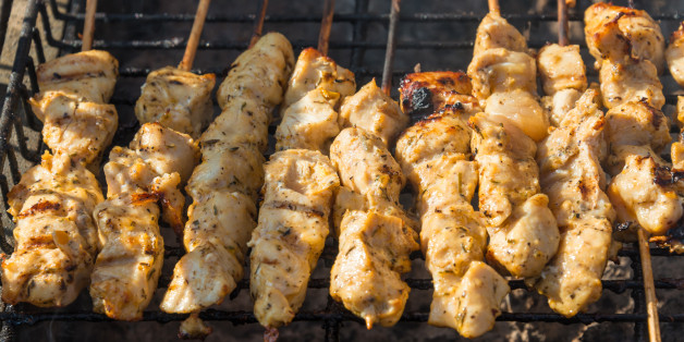TORONTO, ONTARIO, CANADA - 2015/06/20: Meat cooking at the Taste of Little Italy Festival.  Chicken and pork souvlaki (a Greek form of kebabs) sit on a grill. (Photo by Roberto Machado Noa/LightRocket via Getty Images)