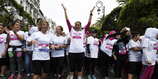 Women wait before taking the start of the 100% women and supportive race, named the Algerian womens race (L'Algeroise) on May 6, 2016 in the capital Algiers. The event, taking place for the first time, is a 3km run intended for women and aims at raising womens awareness on sports. / AFP / Farouk Batiche        (Photo credit should read FAROUK BATICHE/AFP/Getty Images)