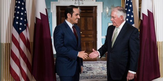 Qatar's Foreign Minister Mohammed bin Abdulrahman al-Thani (L) and US Secretary of State Rex Tillerson shake hands before a meeting at the US State Department on June 27, 2017 in Washington, DC. / AFP PHOTO / Brendan Smialowski        (Photo credit should read BRENDAN SMIALOWSKI/AFP/Getty Images)