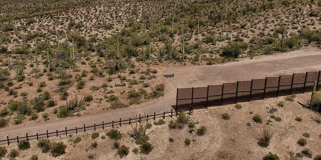 View of the metal fence along the border in Sonoyta, Sonora state, northern Mexico, between the Altar desert in Mexico and the Arizona desert in the United States, on March 27, 2017.Threatened species like the Sonoran pronghorn or desert bighorn sheep freely cross the border between Mexico and the United States in protected biospheres, but the construction of US President Donald Trump's wall will block their movement in these desert valleys and could drive them to extinction. / AFP PHOTO / PEDRO
