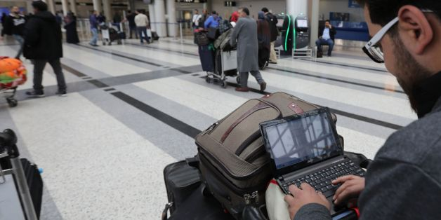 A Syrian passenger travelling to the United States through Amman types on his laptop before entering Beirut international airport's departure lounge on March 22,2017.Hours after the US government warned that extremists plan to target passenger jets with bombs hidden in electronic devices, and banned carrying them in cabins on flights from 10 airports in eight countries in the Middle East and North Africa, Britain tightened airline security on flights from the same region, banning laptops and tab
