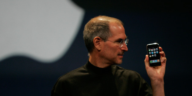 Apple Computer Inc. Chief Executive Officer Steve Jobs holds the new iPhone in San Francisco, California January 9, 2007. Apple unveiled an eagerly-anticipated iPod mobile phone with a touch-screen on Tuesday, priced at $599 for 8 gigabytes of memory, pushing the company's shares up as much as 8.5 percent. Jobs said the iPhone, which also will be available in a 4-gigabyte model for $499, will ship in June in the United States. The phones will be available in Europe in the fourth quarter and in A