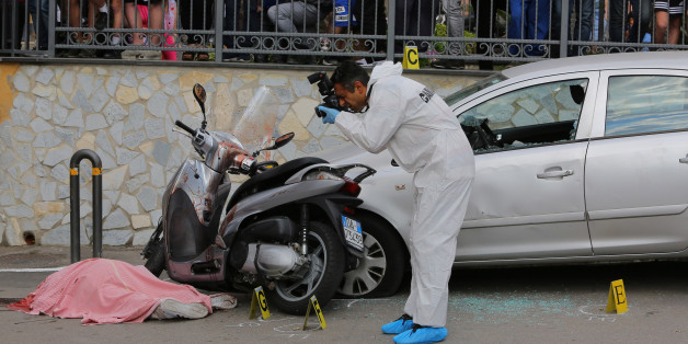 NAPLES, -, ITALY - 2017/05/26: Scientific police investigate on the place where they were killed while on board a scooter the 45-year-old and the 22-year-old whose name is both Carlo Nappello.  The two men killed, uncle and grandson, are suspected to be affiliated the family camorra clan Lo Russo. Carabinieri and Scientific police investigate the place where  two men, a 45-year-old and a 22-year-old, both of whose name is Carlo Nappello, were killed while on board a scooter.  The two men killed,