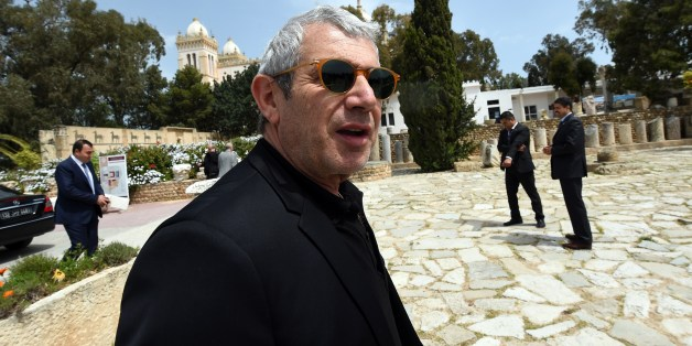 French actor Michel Boujenah visits the archaeological site of Carthage, north of Tunis, on April 18, 2015. A month after the March 18 gun attack on the capital's Bardo National Museum, French Culture Minister Fleur Pellerin and members of a delegation, including Boujenah, visit Tunisia to express their support to the families of the victims and to the Tunisian people.  AFP PHOTO / FETHI BELAID           (Photo credit should read FETHI BELAID/AFP/Getty Images)