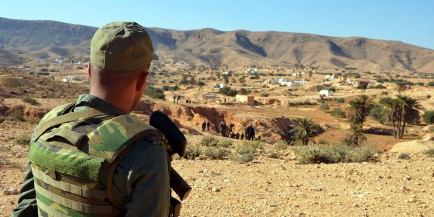 A member of the Tunisian security forces takes part in a security sweep in the mountainous Tounine area, some 30 kilometres (20 miles) south of the coastal town of Gabes, on February 2, 2016. Tunisian forces have killed three suspected jihadists during an ongoing operation in the Gabes region in which one of their men was wounded, the interior ministry said. / AFP / FATHI NASRI        (Photo credit should read FATHI NASRI/AFP/Getty Images)