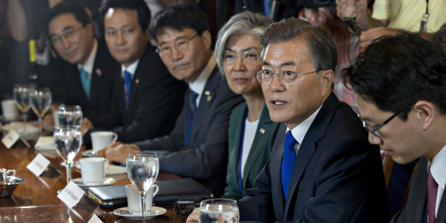 Moon Jae-in, South Korea's president, second right, speaks while meeting with House Republican and Democratic leadership in the speakers conference room at the U.S. Capitol in Washington, D.C., U.S., on Thursday, June 29, 2017. In a speech to business leaders in Washington on Wednesday evening, Moon said the alliance between the nations would only become stronger and stressed the need to resolve the North Korea nuclear issue. Photographer: Andrew Harrer/Bloomberg via Getty Images