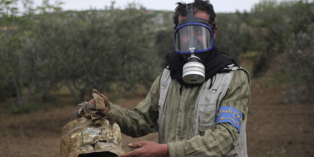 A Civil Defence member carries a damaged canister in Ibleen village from what activists said was a chlorine gas attack, on Kansafra, Ibleen and Josef villages, Idlib countryside May 3, 2015. REUTERS/Abed Kontar