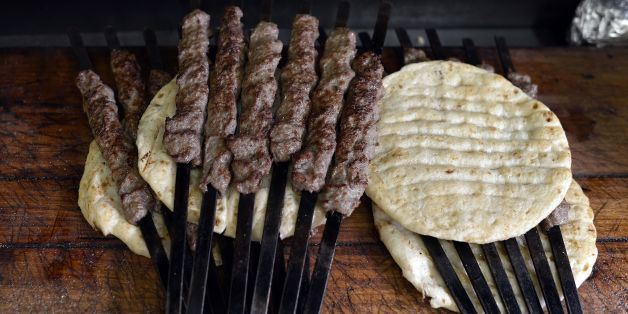 Photo shows skewers of grilled kebab on pita bread at a kebab-souvlaki restaurant in the Monastiraki district of Athens on November 10, 2014. AFP PHOTO/ LOUISA GOULIAMAKI        (Photo credit should read LOUISA GOULIAMAKI/AFP/Getty Images)