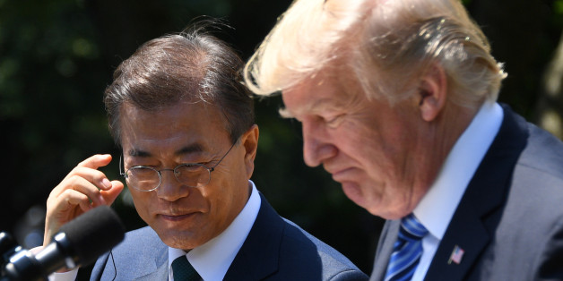 US President Donald Trump (R) and South Korean President Moon Jae-in look on during a joint press conference in the Rose Garden at the White House in Washington, DC, on June 30, 2017. / AFP PHOTO / JIM WATSON        (Photo credit should read JIM WATSON/AFP/Getty Images)