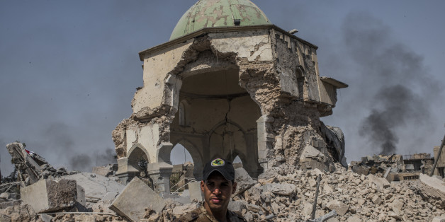 MOSUL, IRAQ - JUNE 30: An Iraqi ISOF forces soldier in front of the destroyed al-Nuri mosque in the Old City of west Mosul where heavy fighting continues on June 30, 2017 in Mosul, Iraq. Iraqi forces continue to encounter stiff resistance from Islamic State with improvised explosive devices (IED's), car bombs, suicide bombers, heavy mortar fire and snipers hampering their advance. (Photo by Martyn Aim/Corbis via Getty Images)