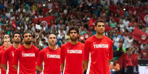 RADES, TUNISIA - AUGUST 29: Tunisia's players sing national anthem before the 2015 FIBA Afrobasket Championship semi finals basketball match between Tunisia and Angola at Omnisport Hall in Rades, Tunisia on August 29, 2015. (Photo by Amine Landoulsi/Anadolu Agency/Getty Images)