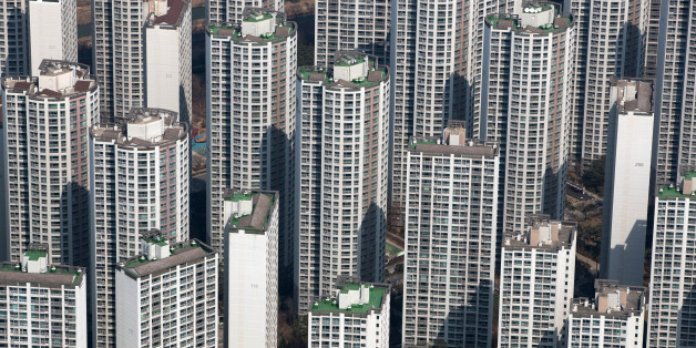 Residential apartment buildings are seen from the observation deck of the Lotte Corp. World Tower in Seoul, South Korea, on Thursday, March 16, 2017. After almost seven years of planning and 4 trillion won ($3.6 billion) in spending,Lotte Group is preparing to unwrap its tower to the public.The building boasts some record-setting amenities: highest glass floor at the top of a building and highest swimming pool. Photographer: SeongJoon Cho/Bloomberg via Getty Images