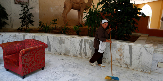 """Khadidja, 60, the only housekeeper kept at her job to maintain the cleanliness of the Imperial Marhaba hotel, which is still closed after it was attacked by a gunman last year, sweeps up the floor at the empty hotel, in Sousse, Tunisia, June 22, 2016. """"We think we will re-open next year,"""" said hotel manager Mehrez Saadi. """"For now we start by changing the name from the Imperial Marhaba to Kantaoui Bay."""" REUTERS/ Zohra Bensemra        SEARCH """"ZOHRA SOUSSE"""" FOR THIS STORY. SEARCH """"THE WIDER IMAGE"""" FOR ALL STORIES"""
