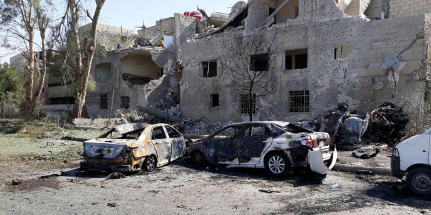 Damaged cars are seen at one of the blast sites in Damascus in this handout picture posted on SANA on July 2, 2017, Syria. SANA/Handout via REUTERS ATTENTION EDITORS - THIS PICTURE WAS PROVIDED BY A THIRD PARTY. REUTERS IS UNABLE TO INDEPENDENTLY VERIFY THE AUTHENTICITY, CONTENT, LOCATION OR DATE OF THIS IMAGE