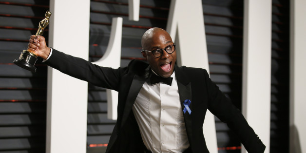"""89th Academy Awards - Oscars Vanity Fair Party - Beverly Hills, California, U.S. - 27/02/17 – Director of """"Moonlight"""" Barry Jenkins holds Best Adapted Screenplay Oscar. REUTERS/Danny Moloshok"""