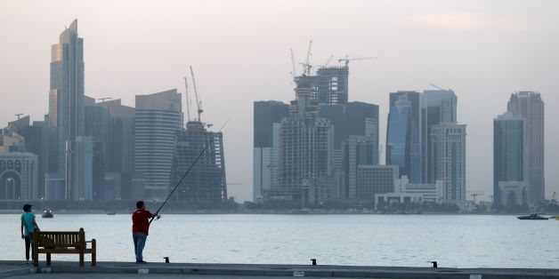 A man fishes off the corniche in the Qatari capital Doha on July 2, 2017. / AFP PHOTO / STR        (Photo credit should read STR/AFP/Getty Images)