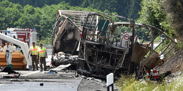 Policemen and forensic experts work at the scene where a tour bus burst into flames following a collision with a trailer truck on the highway A9 near Münchberg, southern Germany, on July 3, 2017, where up to 17 people are feared dead  / AFP PHOTO / Christof STACHE        (Photo credit should read CHRISTOF STACHE/AFP/Getty Images)